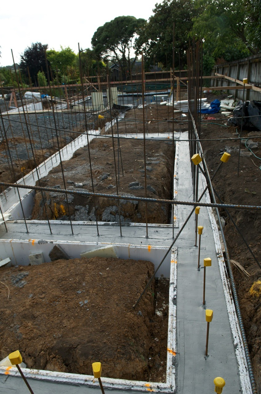 Pouring of the concrete for the footings the new zealand for Best temperature to pour concrete foundation