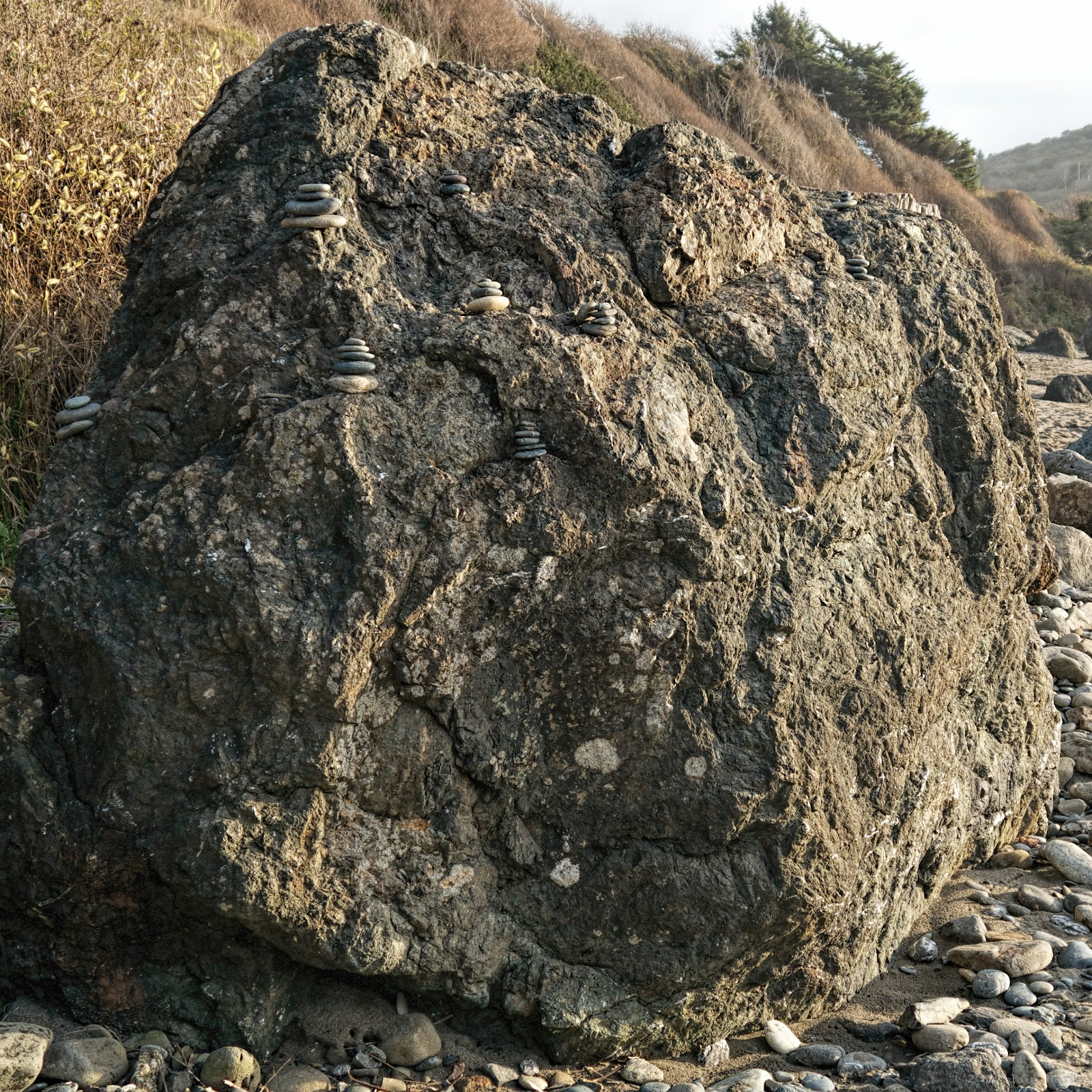 Large rock with zen rock formations on it