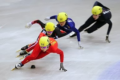 Four speed skaters at the Sochi Winter Olympics