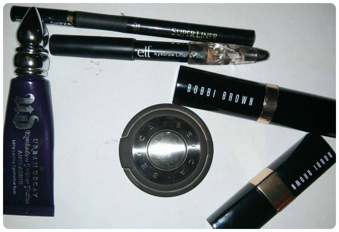urban decay eye primer, becca compact concealer, bobbi brown skin foundation stick warm natural, bobbi brown lipcolor in brown, loreal superliner slim, elf eyebrow lifter and filler