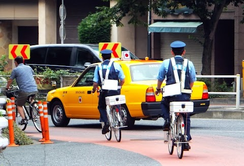 When will cycling laws be enforced in Japan?
