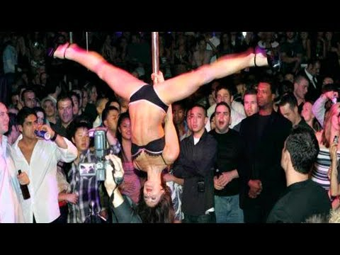 men stares intently at pole dancer