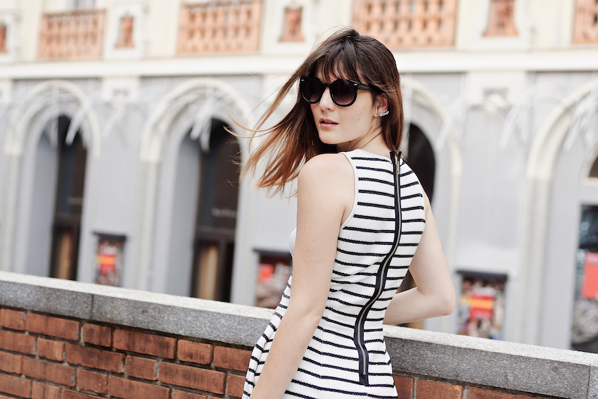 Chic cocktail look featuring a striped raffia dress , white sandals and black accessories.