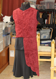Testing the cut fabric on the dress form.