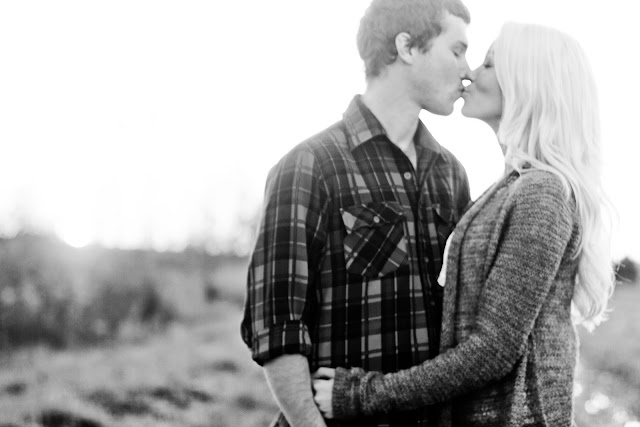 black and white of couple kissing