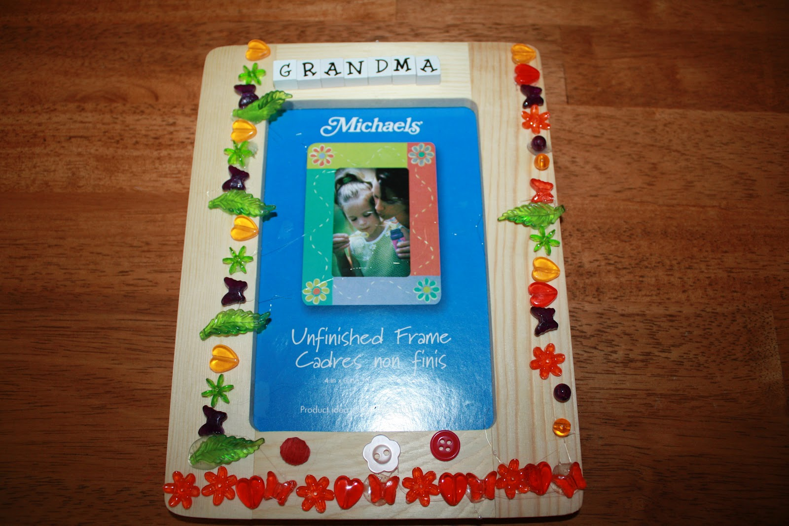 A little time and a keyboard mothers day picture frame craft we decided to make picture frames for the grandmas i happened to have a couple of wood picture frames from michaels my daughter glued all sorts of stray jeuxipadfo Image collections