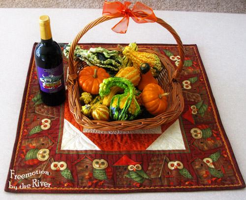 wicker basket of gourds and a bottle of wine @Freemotion by the River