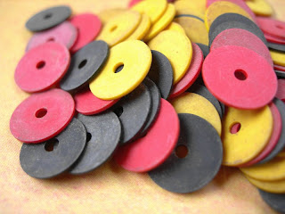 African vinyl vulcanite phonograph sequins in red black and yellow