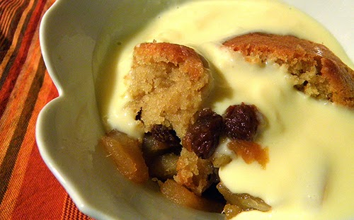 Eve's pudding topped with custard sauce