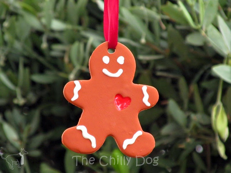 How to make gingerbread man Christmas ornaments out of clay and puff paint.
