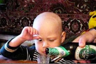 funny picture: child drinking beer