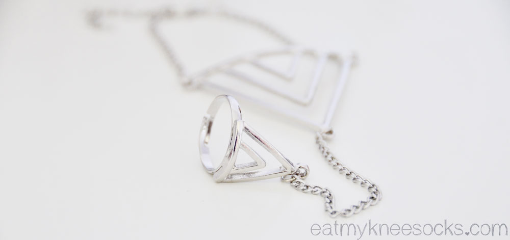 This geometric triangle-design hand chain from Born Pretty Store combines a bracelet and a ring in one.