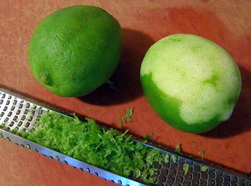 Two Limes, one Being Zested