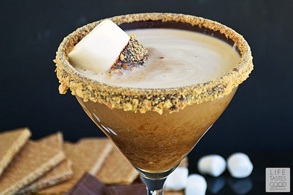 S'moretini | by Life Tastes Good is chocolate liquor, marshmallow infused vodka, and cream served in a martini glass rimmed with chocolate ganache and graham crackers! All of these wonderful flavors combine to make a drink that tastes like our favorite camping treat - s'mores! It makes a super fun party cocktail too!