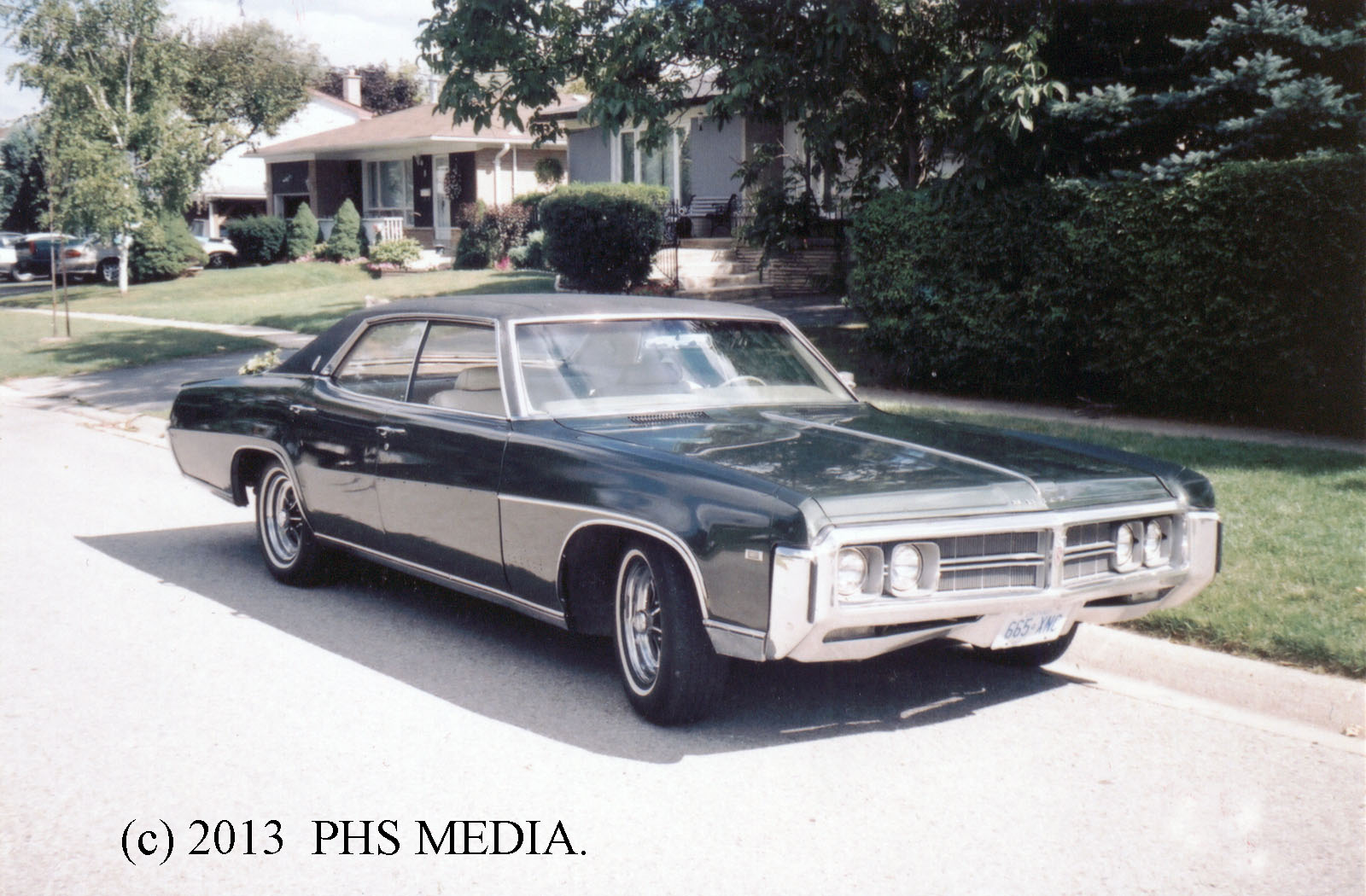 He wound up with a dark metallic green with black vinyl top and chromed buick mags