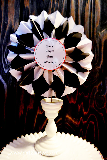use wrapping paper to create paper flowers, fans made from wrapping paper