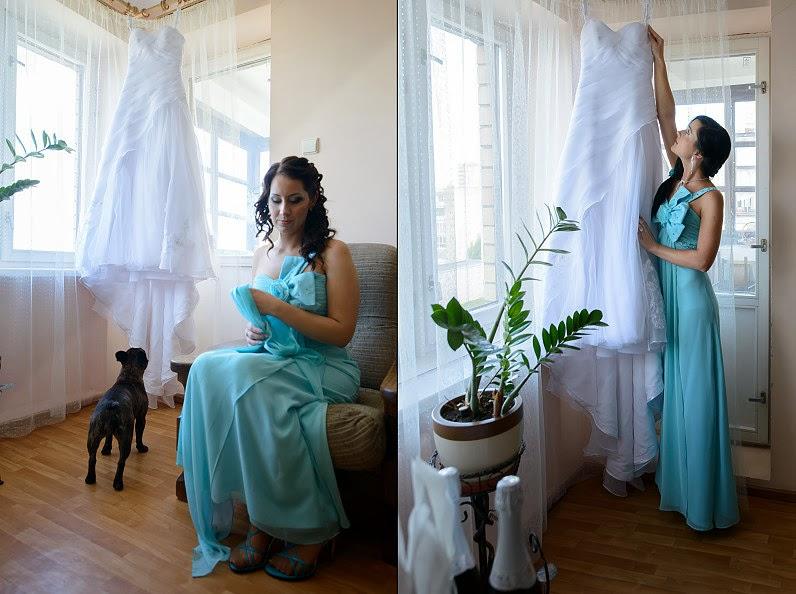 vestuvinė nuotakos suknelė kabo priešais langą