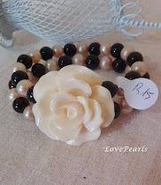 Bracciale elastico due fili di perle onice nero rosa in resina bianca R15