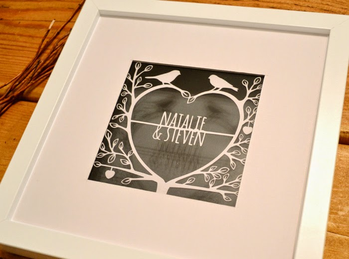 http://www.paperpetal.co.uk/love_tree_design_papercut_framed_artwork.html