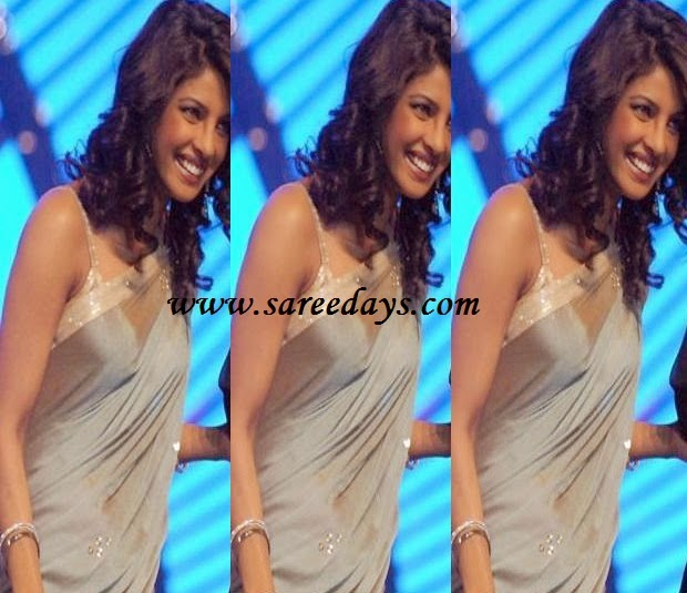 Latest saree designs priyanka chopra in gray chiffon designer saree checkout priyanka chopra in gray chiffon designer saree with silver appliqued border and silver work on the saree and paired with silver noodle strap altavistaventures Images