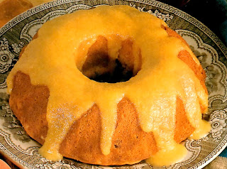 A classic peach-flavoured sponge pudding baked in a ring mould served topped with a peach sauce