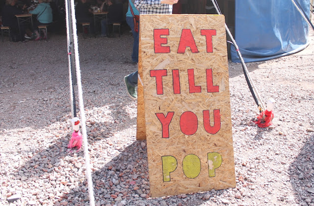 eat till you pop sign at festival