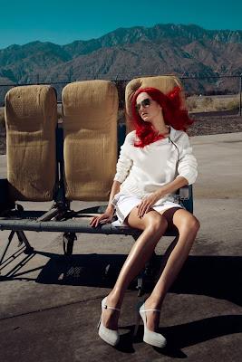 woman waiting at airport, fashion photography, top fashion photographers nyc