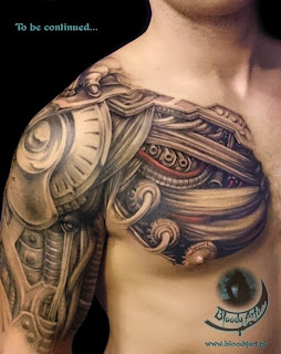 Biomechanical tattoo on the chest, shoulder and upper arm
