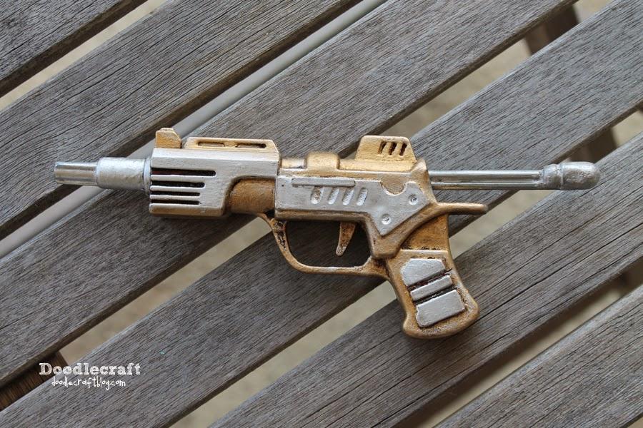 http://www.doodlecraftblog.com/2014/06/steampunk-dart-gun-with-rub-n-buff.html