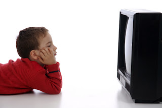 image of kid watching tv
