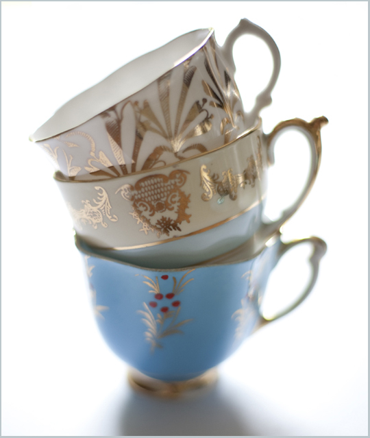 stack of gold and blue teacups