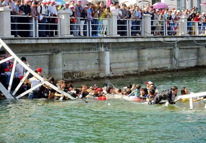 CCTV shows the moment dozens of visitors to a park in China's Jiangxi Province are sent tumbling into the water, triggering a frantic rescue effort.