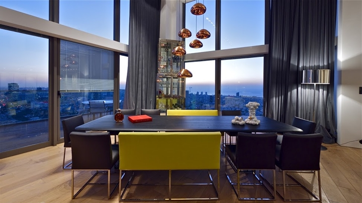 Dining table in Triplex penthouse apartment by Pitsou Kedem