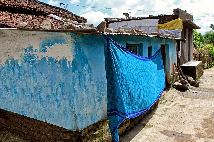 sari drying on a village wall