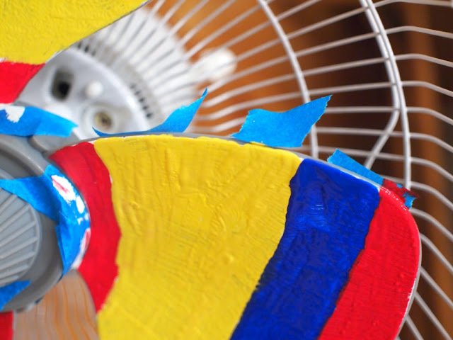 paint your fan red, yellow, and blue to make a rainbow