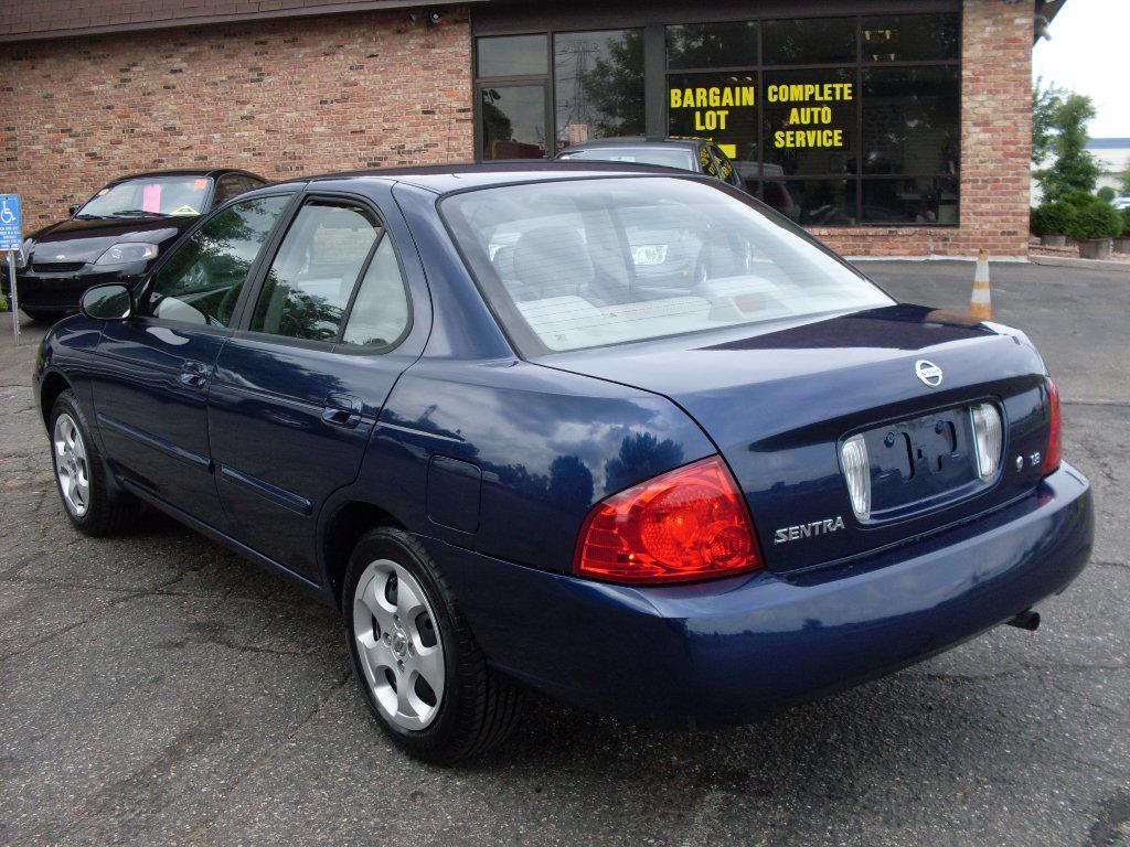 Nissan Sentra Blue on 2002 Dodge Durango Black