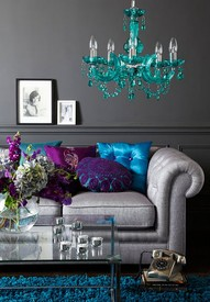 dark gray wall light gray couch turquoise chandelier shades of blues purple pillows and blue shag rug love - Turquoise Chandelier Light