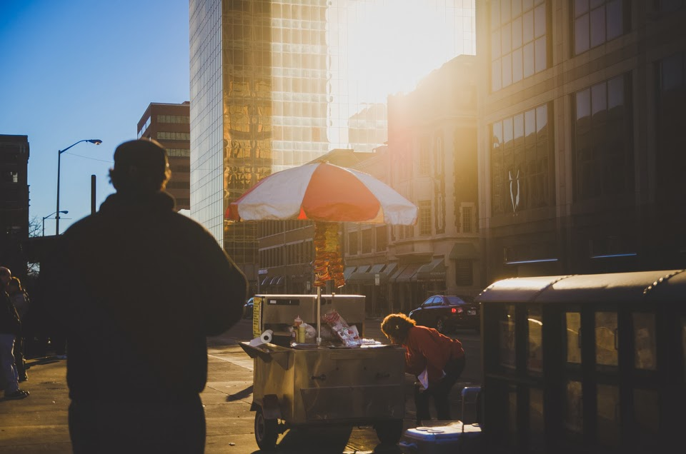 back lit photograph of street vendor in downtown indianapolis