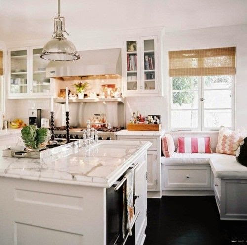 beautiful traditional kitchen with built in banquette dining table seating marble island