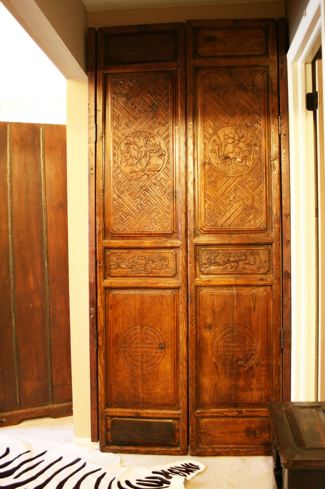 antique chinese doors used as closet doors in my master bedroom these