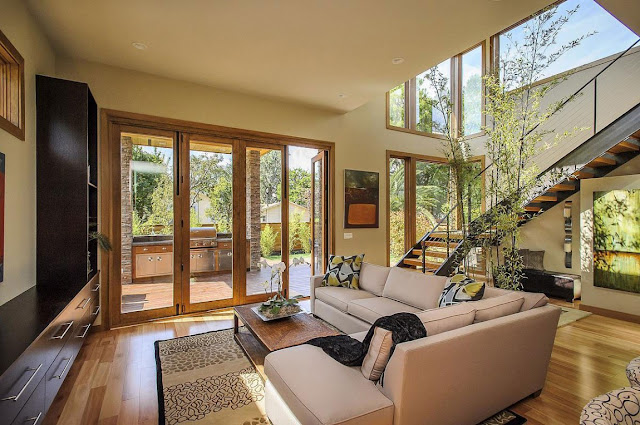 Contemporary living room with brown colors