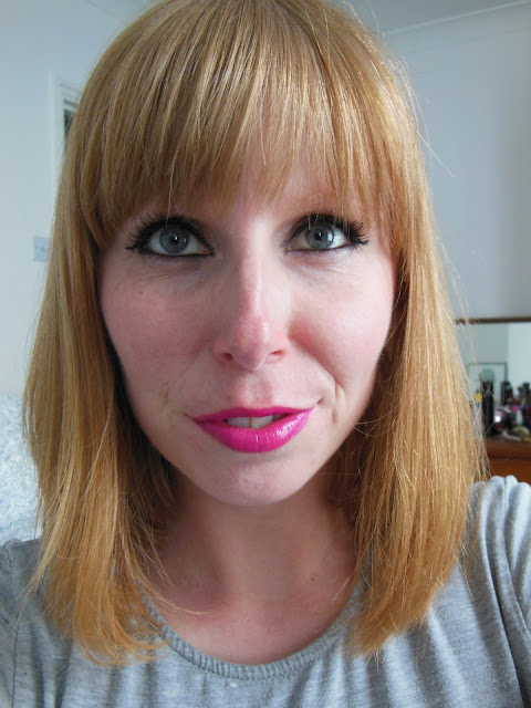 Wearing Urban Decay Anarchy lipstick on lips