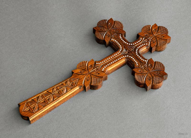wooden cross with carving
