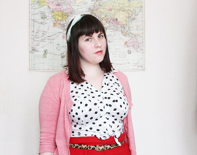 outfit post on cardboardcities blog - pink cardigan, polka dot blouse, leopard print belt and red pom pom skirt