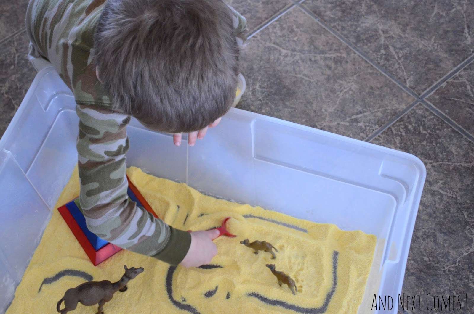 Digging in an Egyptian desert sensory bin from And Next Comes L