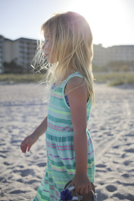 profile of little girl on the beach