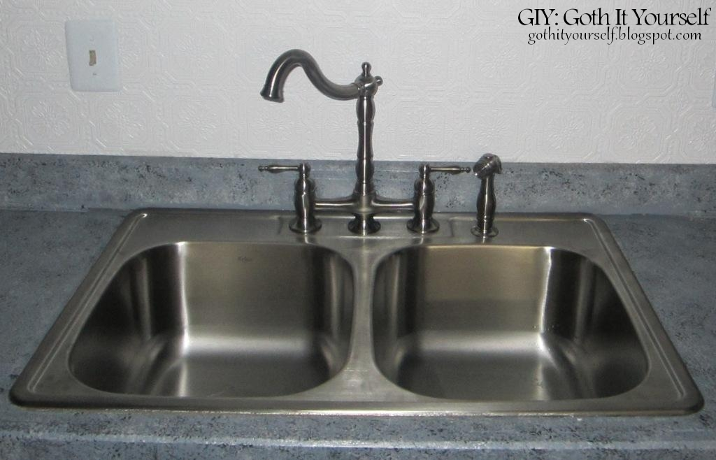 The Old Sink Was Badly Scratched And The Old Faucet Was Cheap And Hard To  Turn.