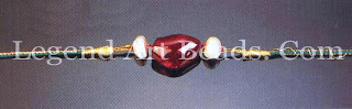 BAZUBAND (armlet) Mughal; 17 century Christies Images the single spinet flanked by baroque pearls weighs 79.55 carats and is inscribed 'Shah Jahangir bin Akbar Shah, 7010 AN' (1601 A.D.). Portraits of Mughal emperors often depict them wearing such elegantly simple jewels. Uncut and devoid of a complex gold setting, large gems were highly prized. They were inscribed to establish ownership and were handed down from generation to generation.