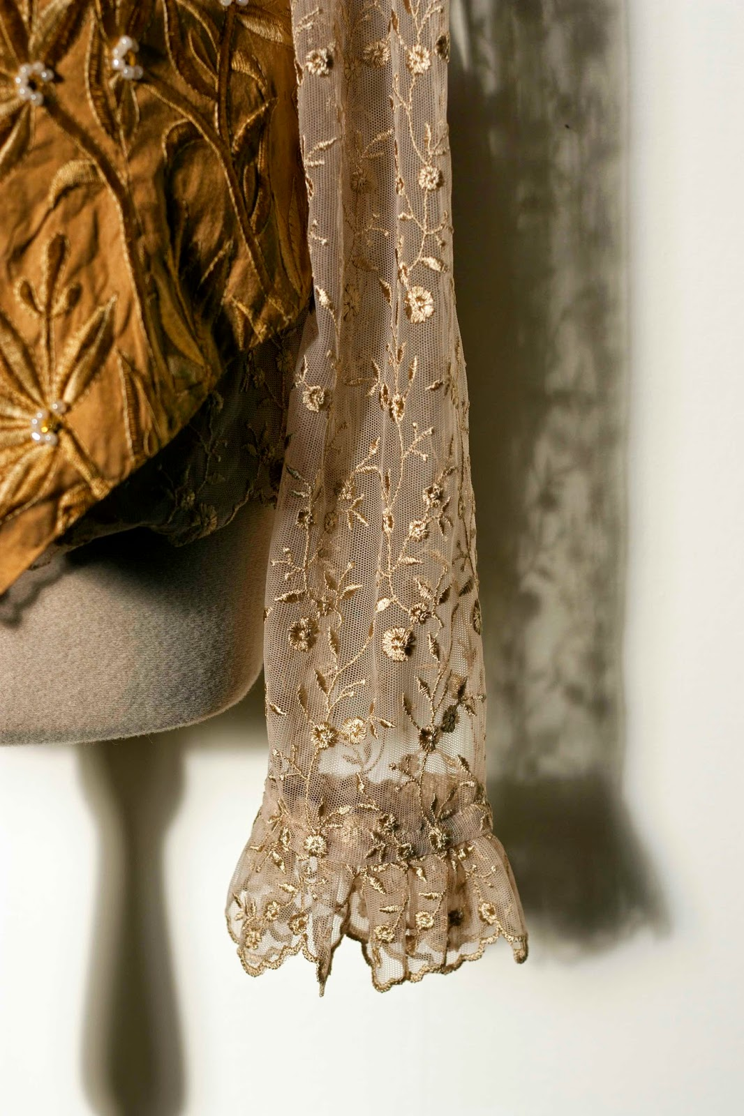 cuff and sleeve of the blouse with part of the vest
