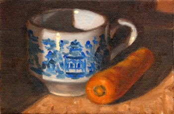 Oil painting of a blue and white Willow pattern teacup beside a carrot.